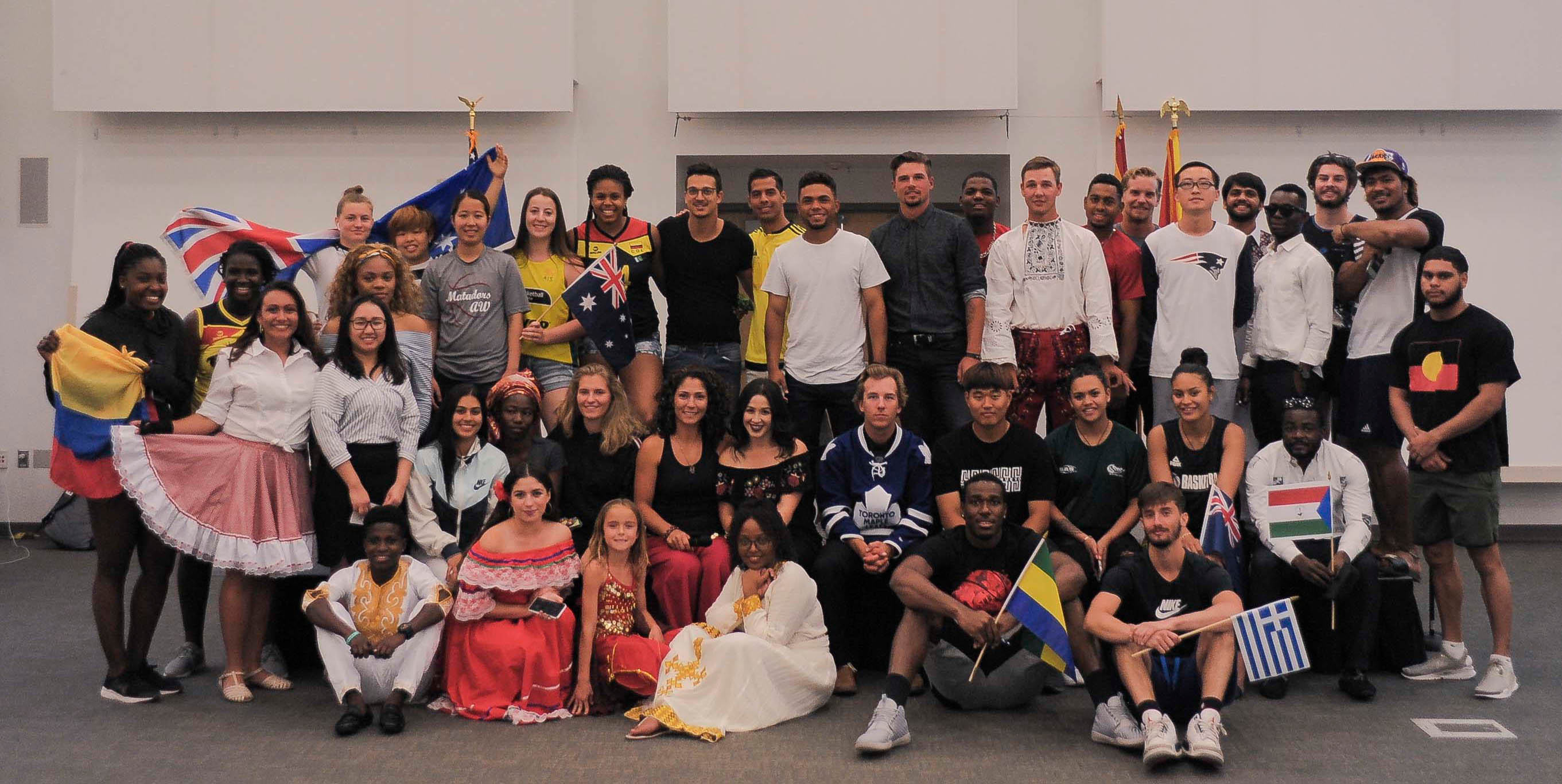 Large group of participants in various outfits from different cultures