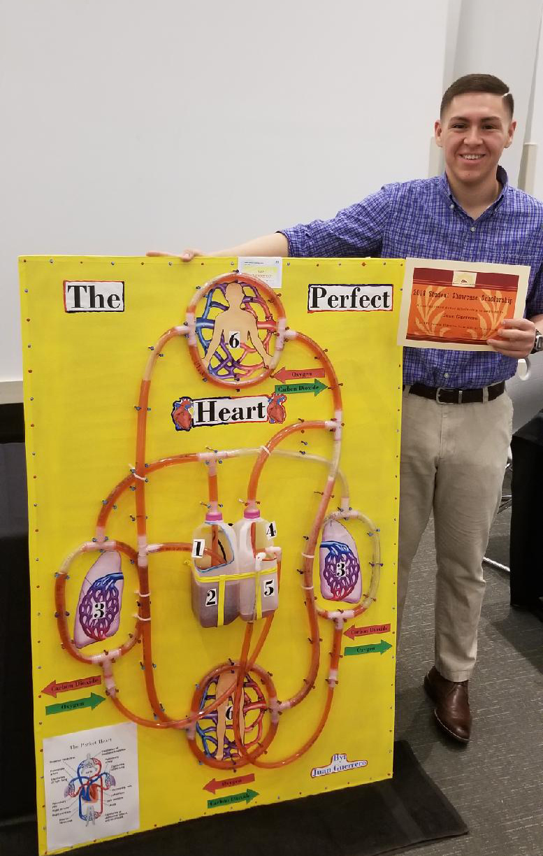 """Juan Guerrero won $1,000 for his project on scientific literacy, """"The Perfect Heart."""""""