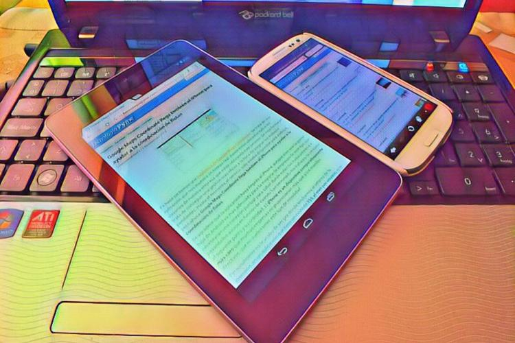 Colorful tablet and phone displayed on a laptop