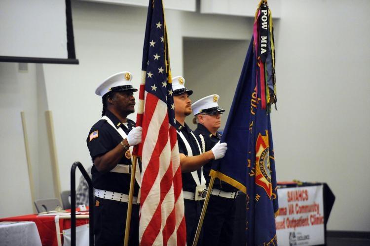 Veterans holding flags